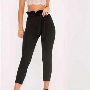 Black paper bag skinny trousers. Brand new